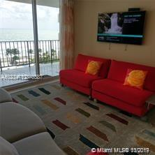 Photo of 2030 Ocean Dr #716, Hallandale, Florida, 33009 - LIVING ROOM WITH SEEMLSS DIRECT OCEAN TERRACE VIEWS