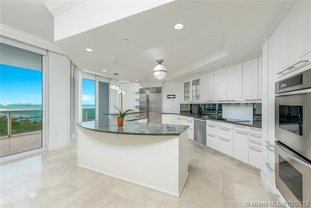 Photo of 10225 Collins Ave #901, Bal Harbour, Florida, 33154 - Oversized eat-in kitchen featuring double ovens, wine fridge, warming oven and unobstructed ocean views.