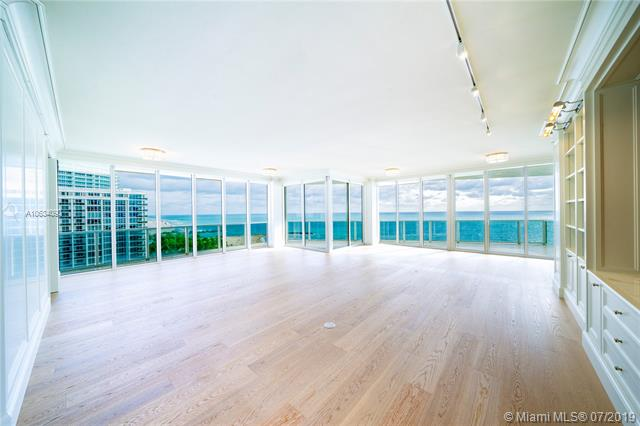 Photo of 10225 Collins Ave #901, Bal Harbour, Florida, 33154 - Expansive living and dining rooms featuring 10+ ft ceilings, Canadian hard-wood floors, custom build outs, built-in bar, paneled walls and unobstructed ocean views.