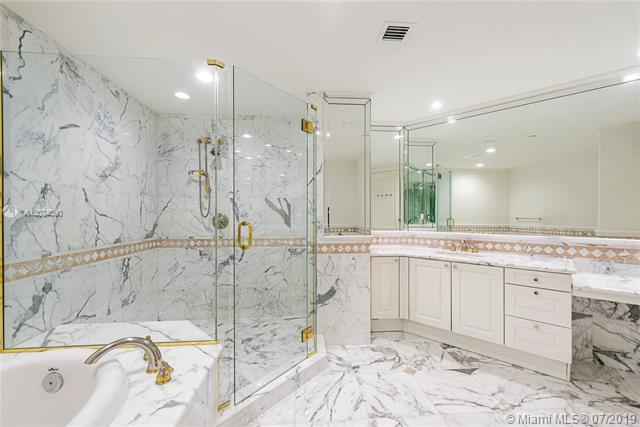 Photo of 10225 Collins Ave #901, Bal Harbour, Florida, 33154 - Master suite full bathroom #1 with vanity, shower and bathtub.