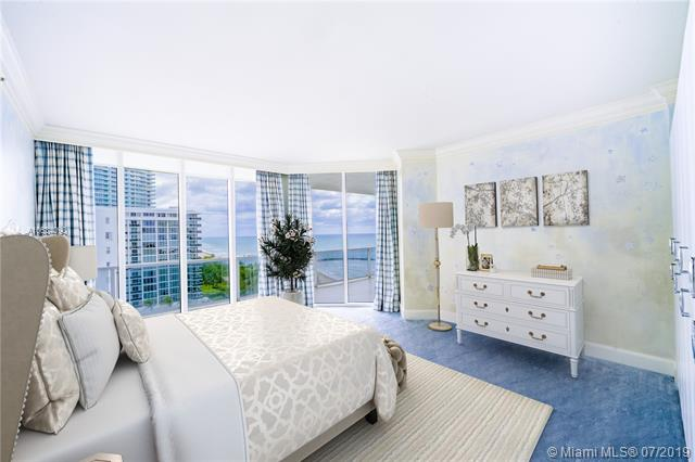 Photo of 10225 Collins Ave #901, Bal Harbour, Florida, 33154 - Digitally staged second bedroom featuring unobstructed ocean views, access to balcony, hand-painted walls, custom build-outs and en-suite bathroom.