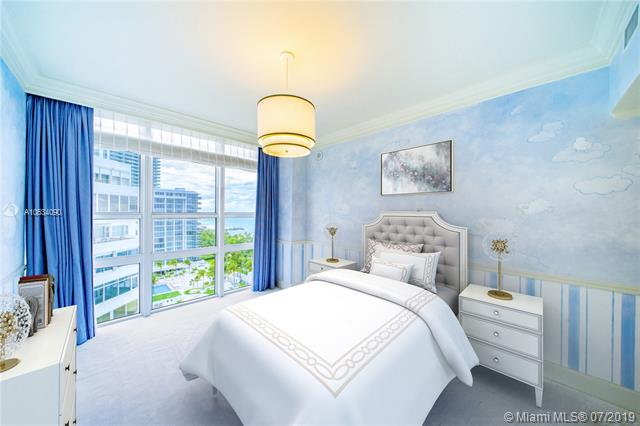 Photo of 10225 Collins Ave #901, Bal Harbour, Florida, 33154 - Digitally staged third bedroom with walk-in closet and en-suite bathroom.