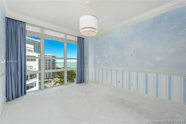 Photo of 10225 Collins Ave #901, Bal Harbour, Florida, 33154 - Bedroom #3 featuring ocean views, hand-painted walls and walk-in closet.