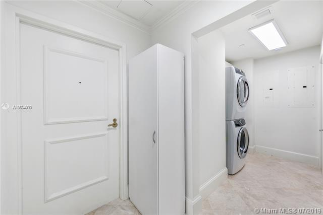 Photo of 10225 Collins Ave #901, Bal Harbour, Florida, 33154 - Utility room with ample storage and separate entrance.