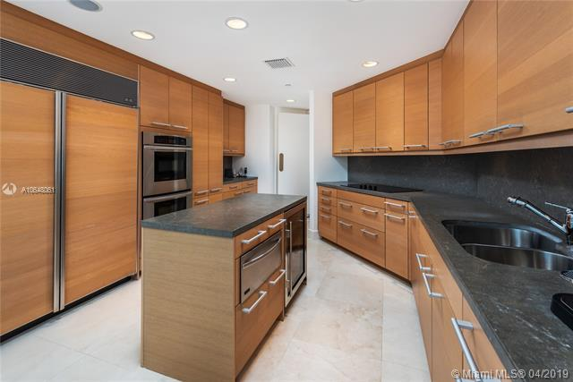 Photo of 10225 Collins Ave #1103, Bal Harbour, Florida, 33154 - Sleek eat-in kitchen.