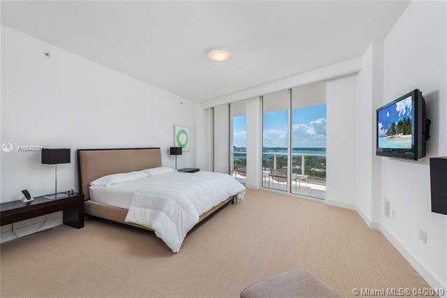 Photo of 10225 Collins Ave #1103, Bal Harbour, Florida, 33154 - Chic master suite with spacious seating area and entry onto terrace.