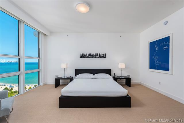 Photo of 10225 Collins Ave #1103, Bal Harbour, Florida, 33154 - Second bedroom with sitting area, endless ocean views and entry onto terrace.