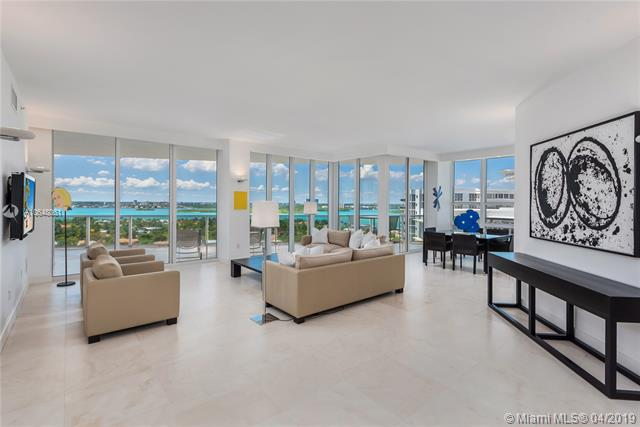 Photo of 10225 Collins Ave #1103, Bal Harbour, Florida, 33154 - Grand living room and dining area with views of the Intracoastal Waterway, Haulover Sandbar and city.