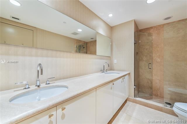 Photo of 10225 Collins Ave #1103, Bal Harbour, Florida, 33154 - Second bedroom's en-suite bathroom.