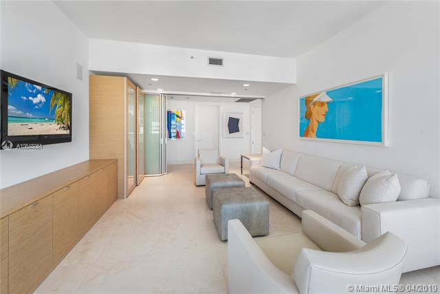 Photo of 10225 Collins Ave #1103, Bal Harbour, Florida, 33154 - Convertible third bedroom/family room with sliding privacy doors open.