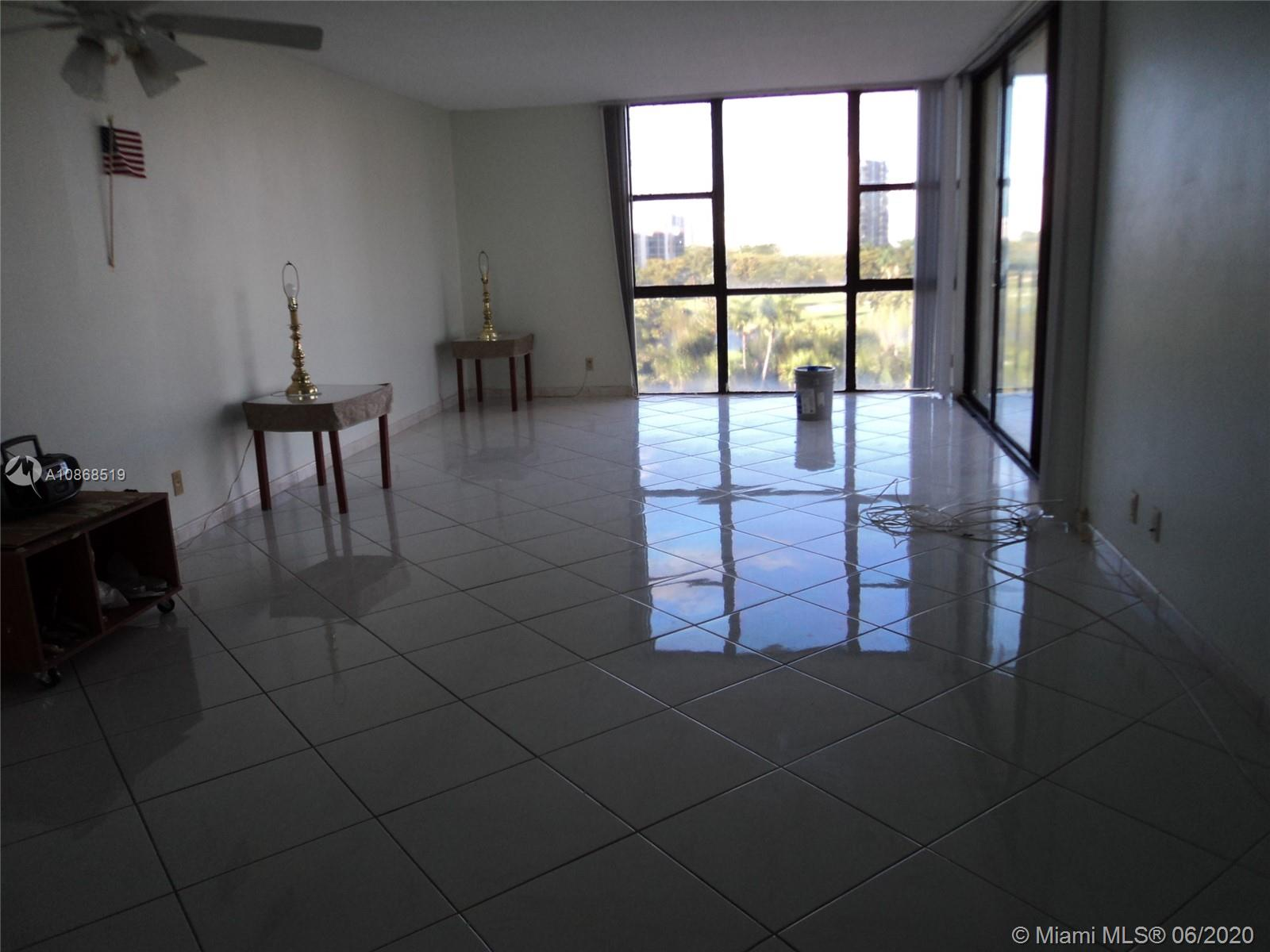 Photo of 20301 Country Club Dr #623, Aventura, Florida, 33180 - Large Living Room Almost 30 Feet Long .  All Rooms have a view to the golf course.