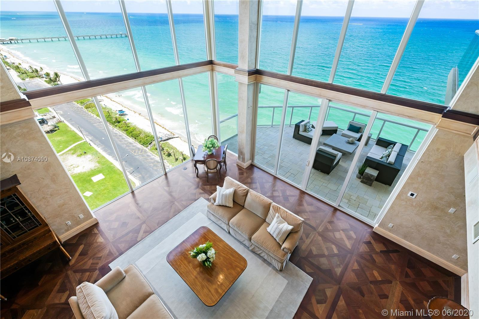 Photo of 6051 Ocean Dr #PH5, Hollywood, Florida, 33019 - Views from upstairs landing to living room
