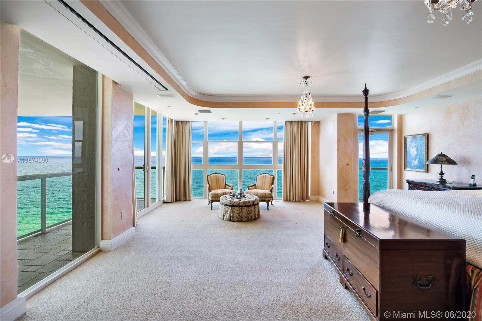 Photo of 6051 Ocean Dr #PH5, Hollywood, Florida, 33019 - Master bedroom suite with private balconies and seating area