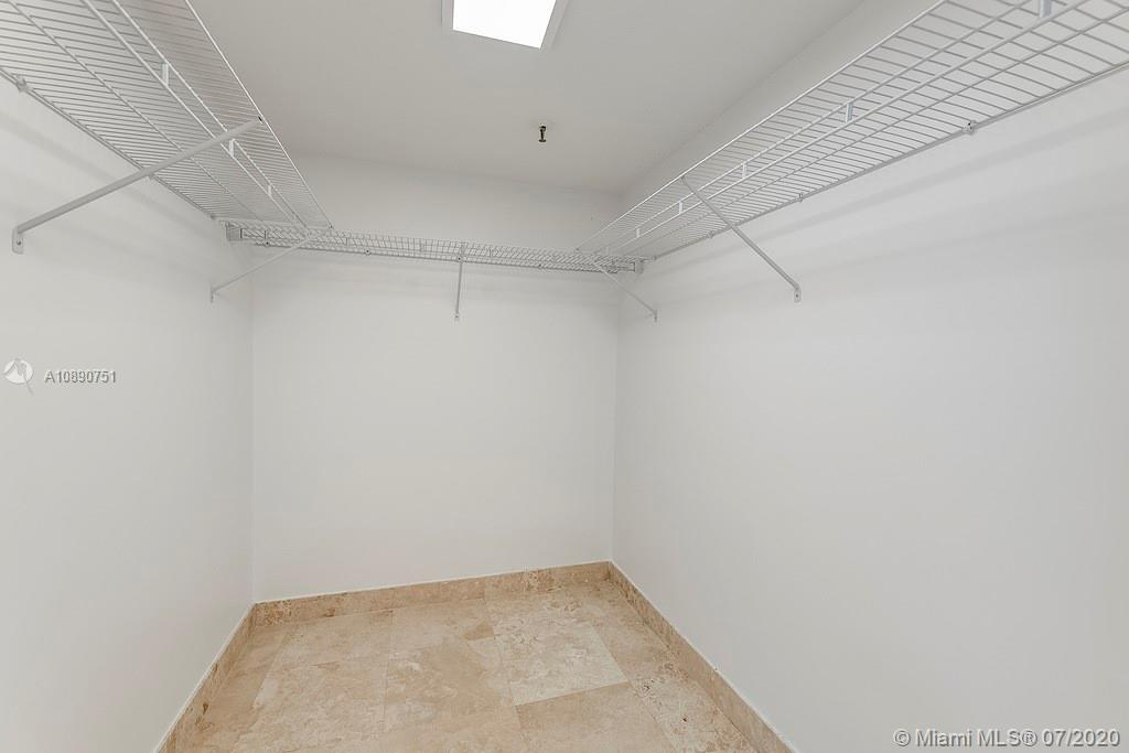 Photo of 425 Poinciana Island Drive #1444, Sunny Isles Beach, Florida, 33160 - Conveniently located laundry closet in between the bedrooms