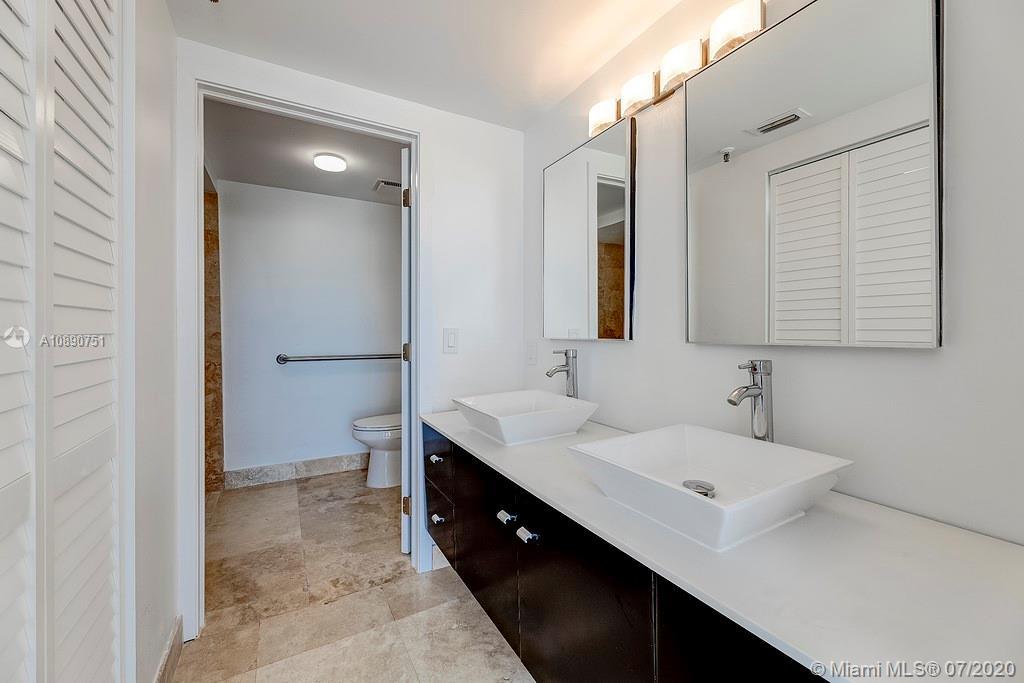 Photo of 425 Poinciana Island Drive #1444, Sunny Isles Beach, Florida, 33160 - Living room / dining room area facing the bar feature