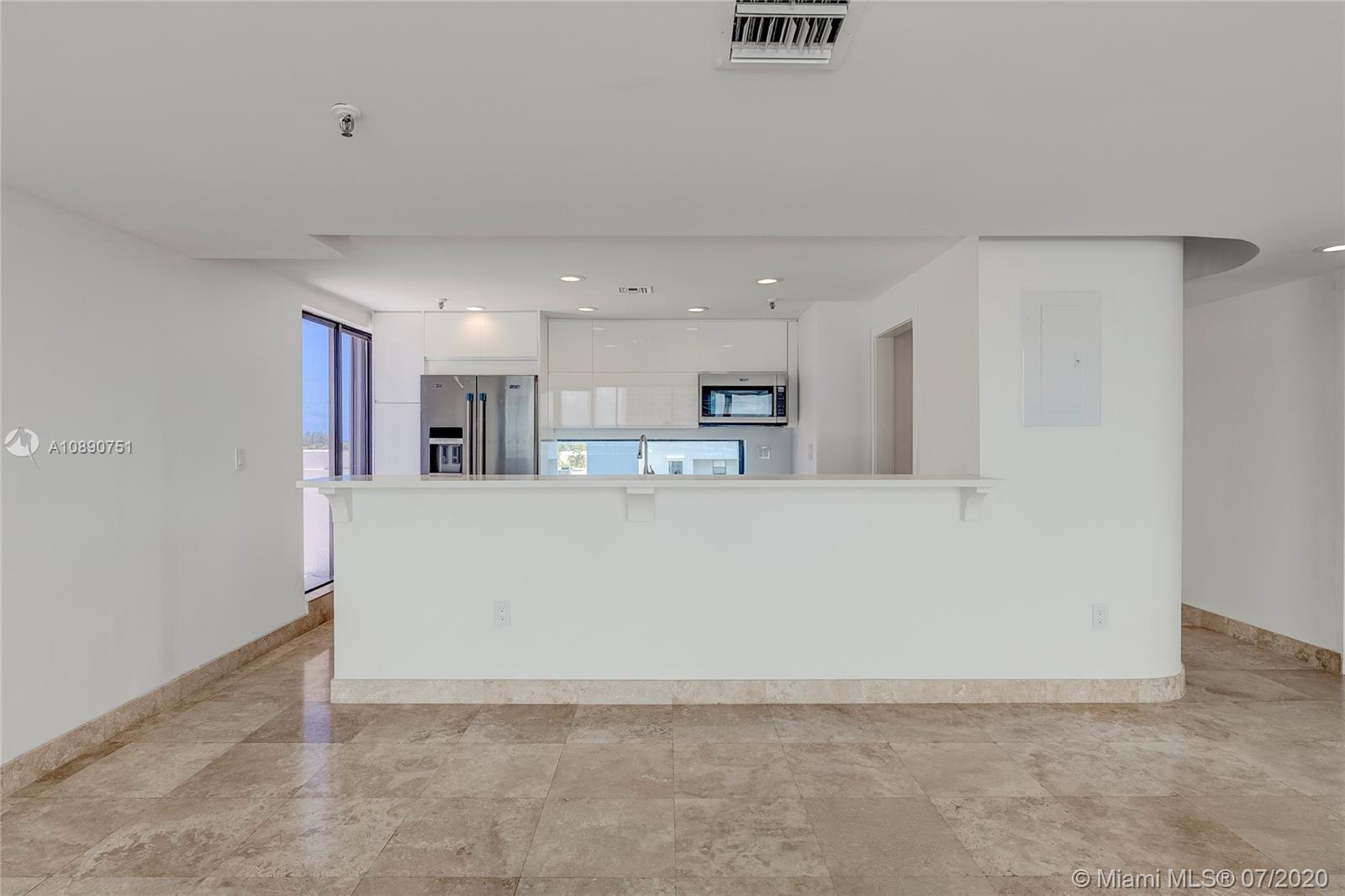 Photo of 425 Poinciana Island Drive #1444, Sunny Isles Beach, Florida, 33160 - Terrace view from living room area to the terrace in front of the primary bedroom
