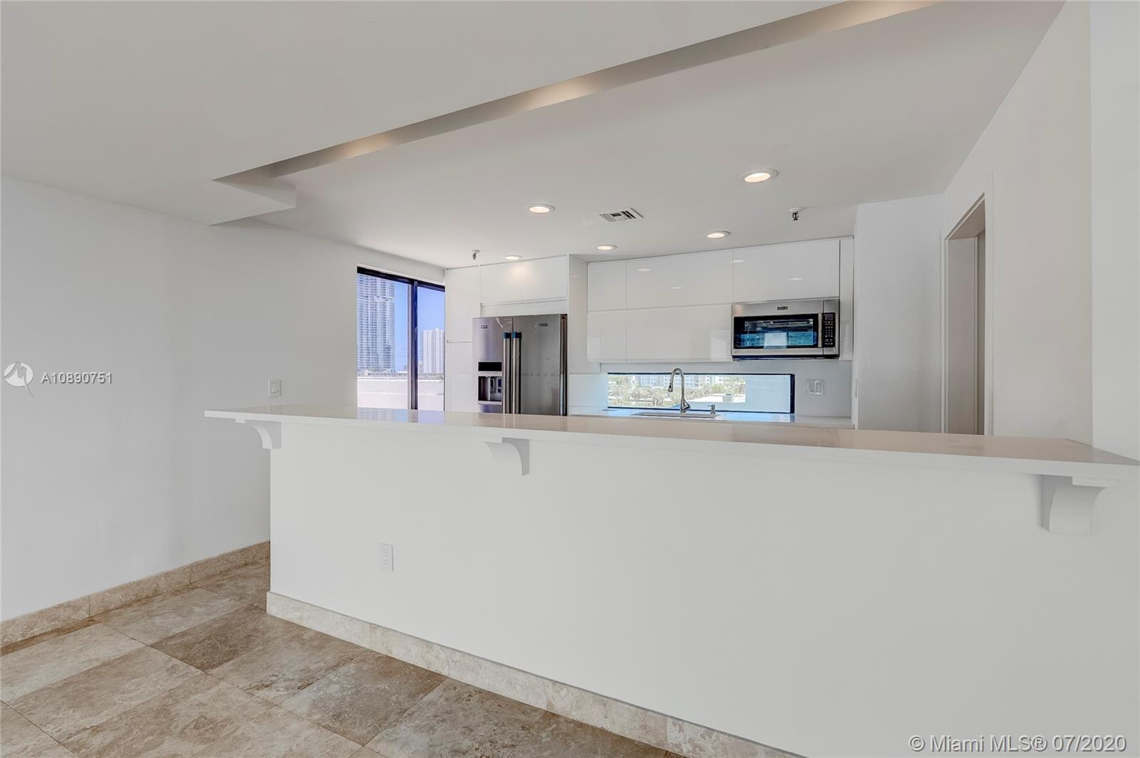 Photo of 425 Poinciana Island Drive #1444, Sunny Isles Beach, Florida, 33160 - Quartz bar feature with seating for six