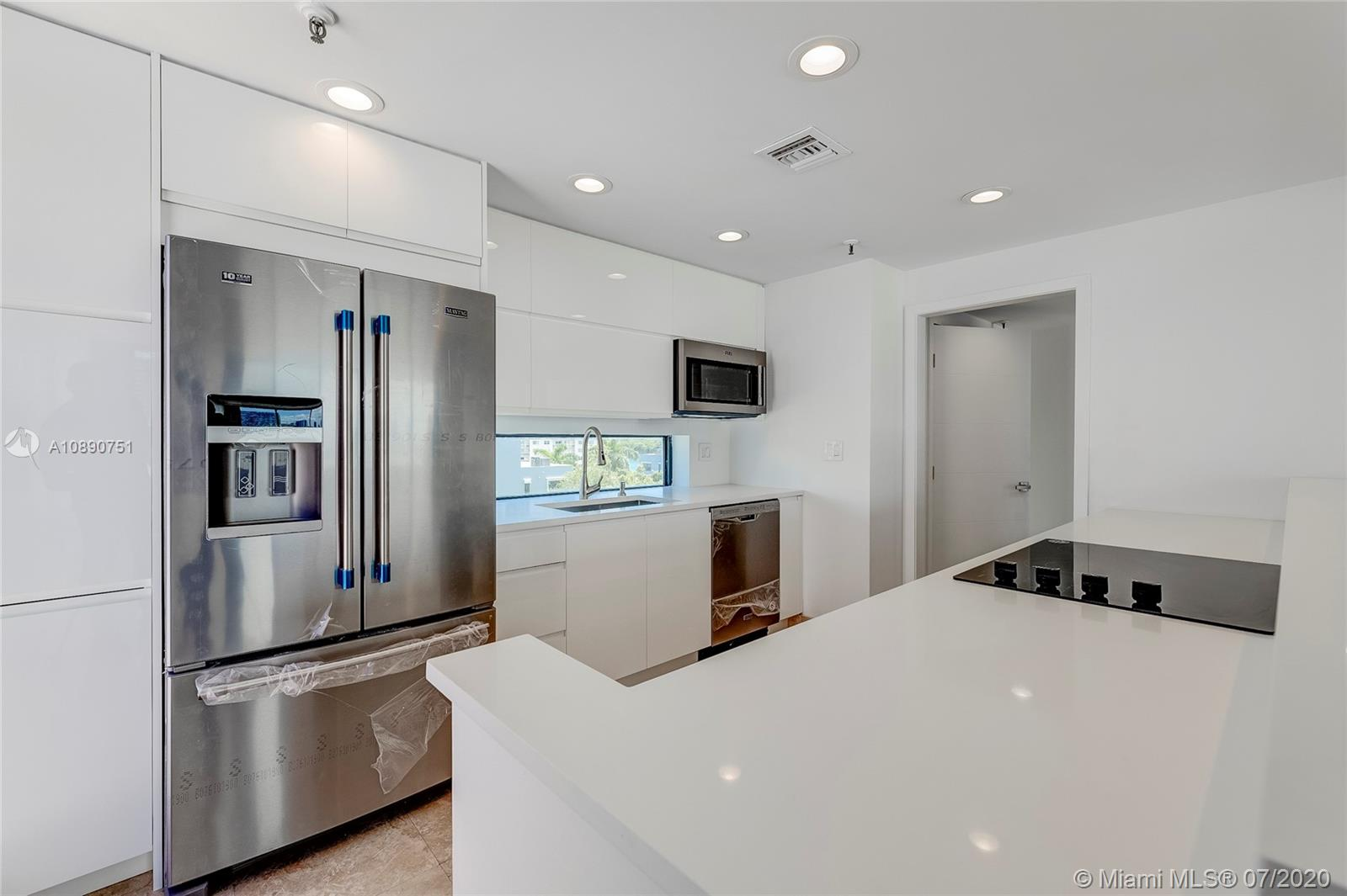 Photo of 425 Poinciana Island Drive #1444, Sunny Isles Beach, Florida, 33160 - Kitchen view from east terrace to hallway and powder room