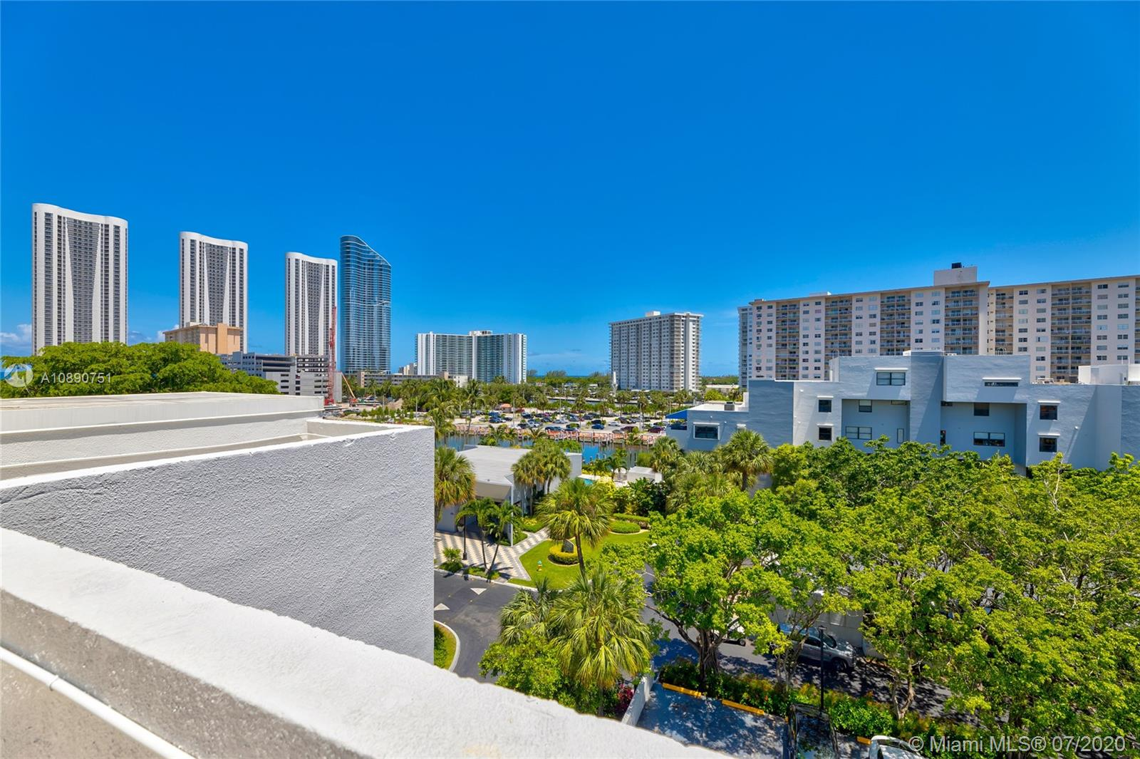 Photo of 425 Poinciana Island Drive #1444, Sunny Isles Beach, Florida, 33160 - Kitchen with views to the north terrace