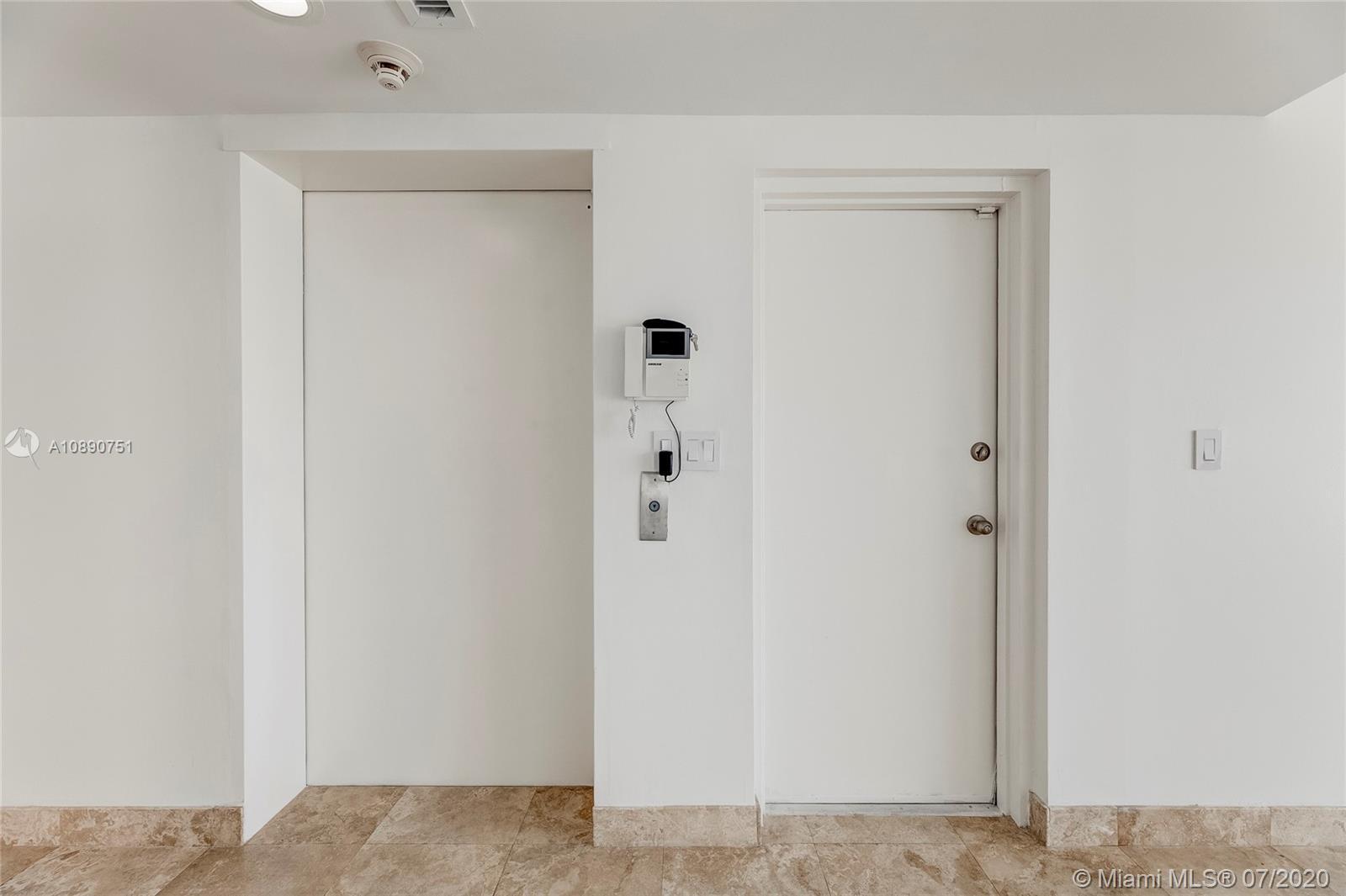 Photo of 425 Poinciana Island Drive #1444, Sunny Isles Beach, Florida, 33160 - Guest powder room off main living area