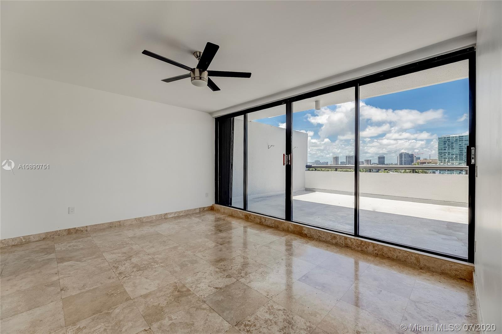 Photo of 425 Poinciana Island Drive #1444, Sunny Isles Beach, Florida, 33160 - View through floor to ceiling windows upon entrance to primary bedroom