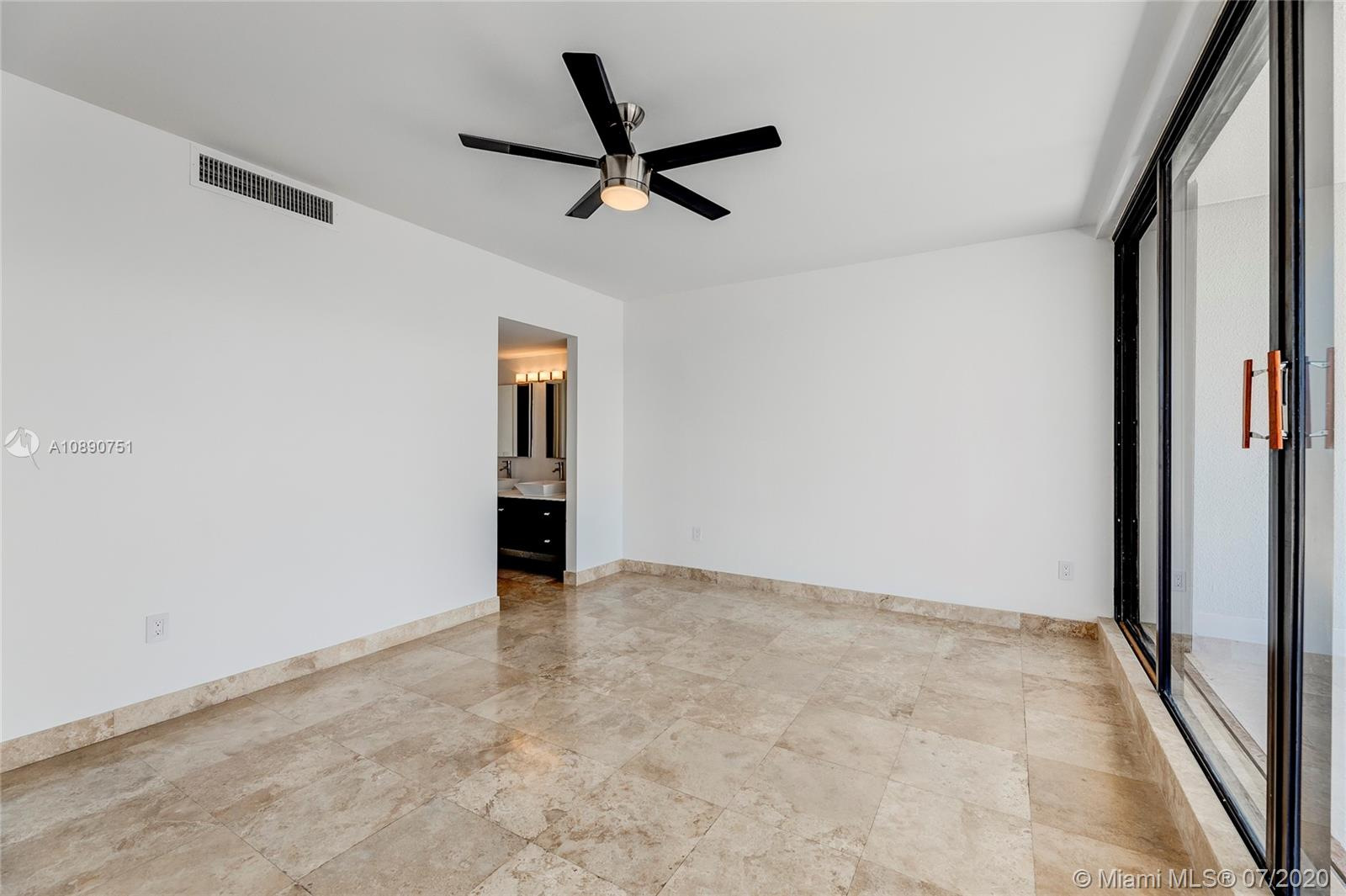 Photo of 425 Poinciana Island Drive #1444, Sunny Isles Beach, Florida, 33160 - Floor to ceiling windows provides direct access to terrace from primary bedroom