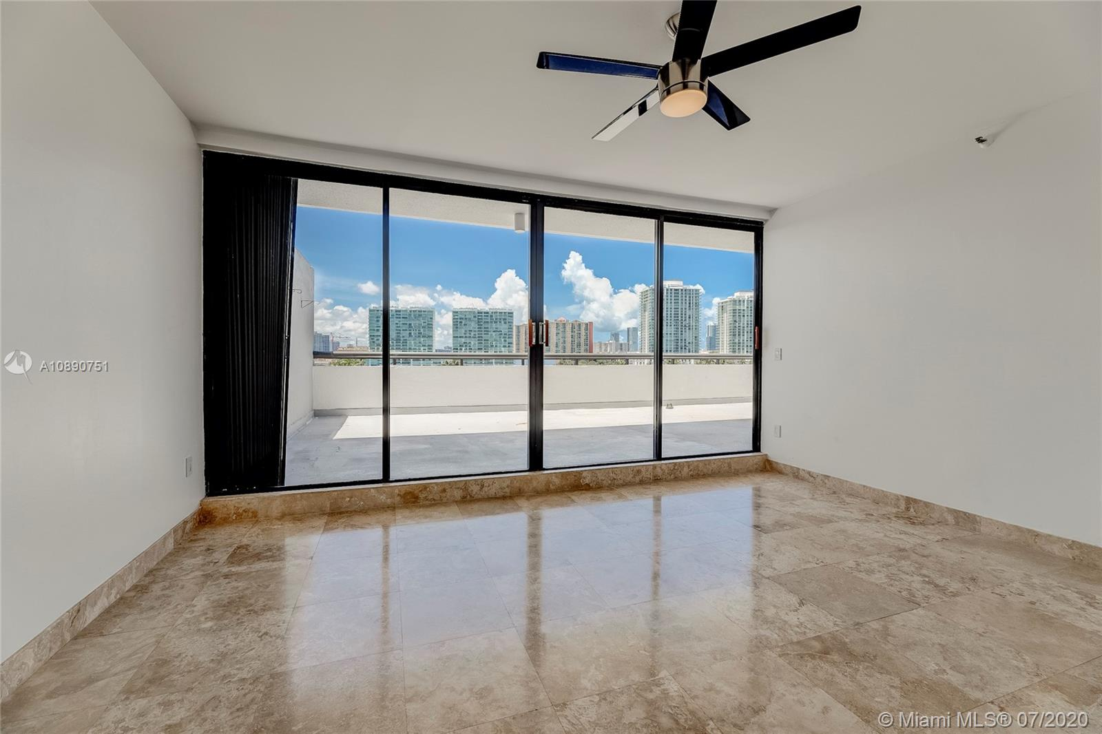Photo of 425 Poinciana Island Drive #1444, Sunny Isles Beach, Florida, 33160 - Entrance to primary bedroom with view to en suite dressing area