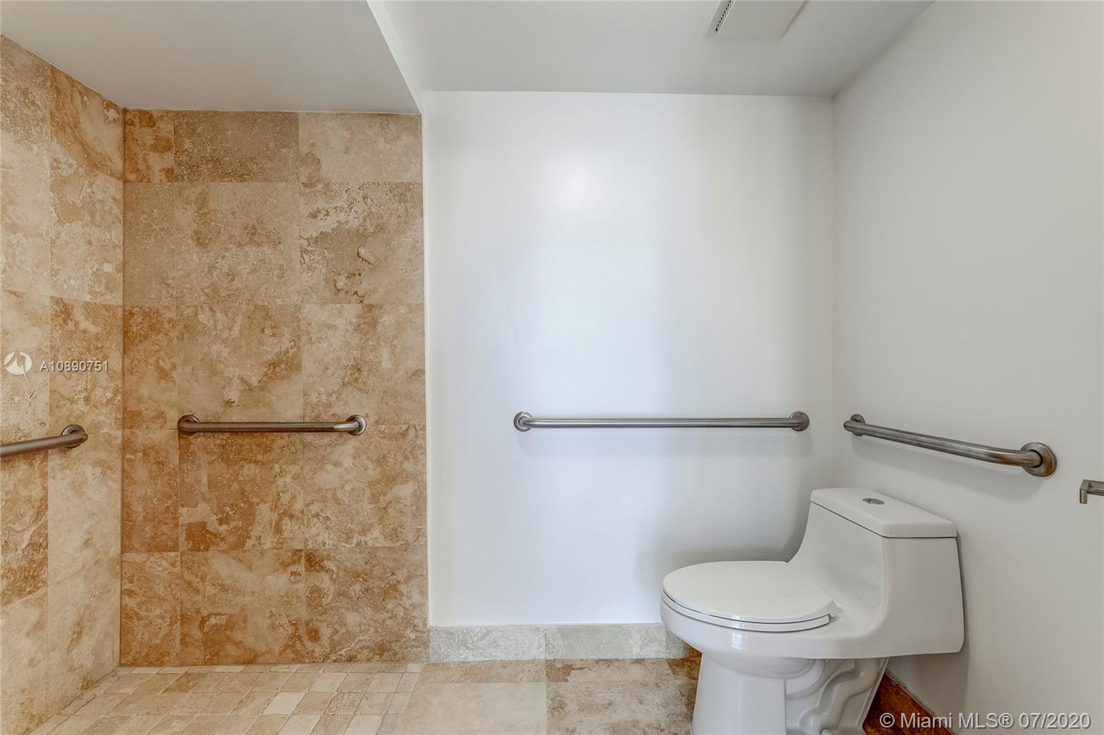 Photo of 425 Poinciana Island Drive #1444, Sunny Isles Beach, Florida, 33160 - En suite bathroom with dressing are in primary bedroom with double vanity and safety features
