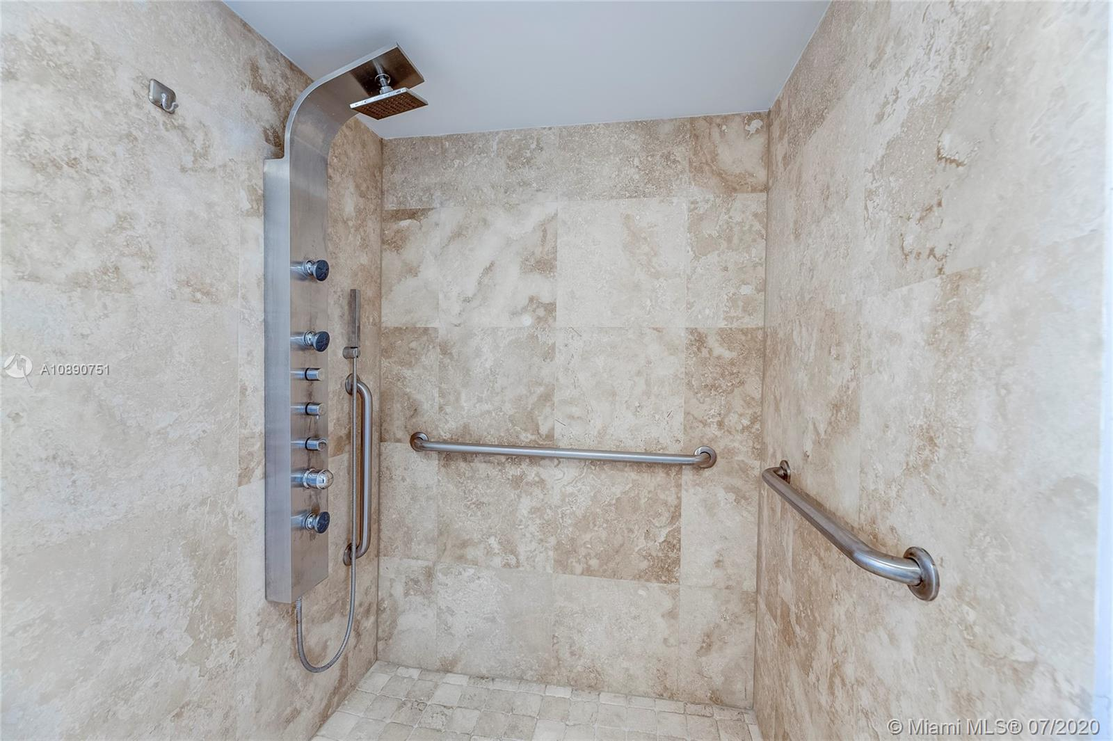 Photo of 425 Poinciana Island Drive #1444, Sunny Isles Beach, Florida, 33160 - Primary bedroom en suite bathroom with enlarged shower, safety features and comfort height toilet