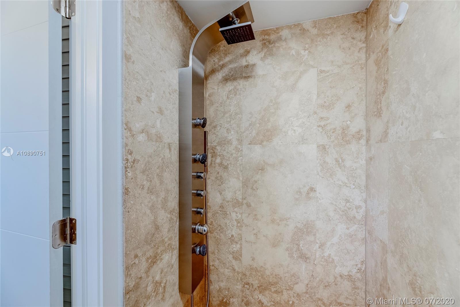 Photo of 425 Poinciana Island Drive #1444, Sunny Isles Beach, Florida, 33160 - Second room dressing area and en suite bathroom