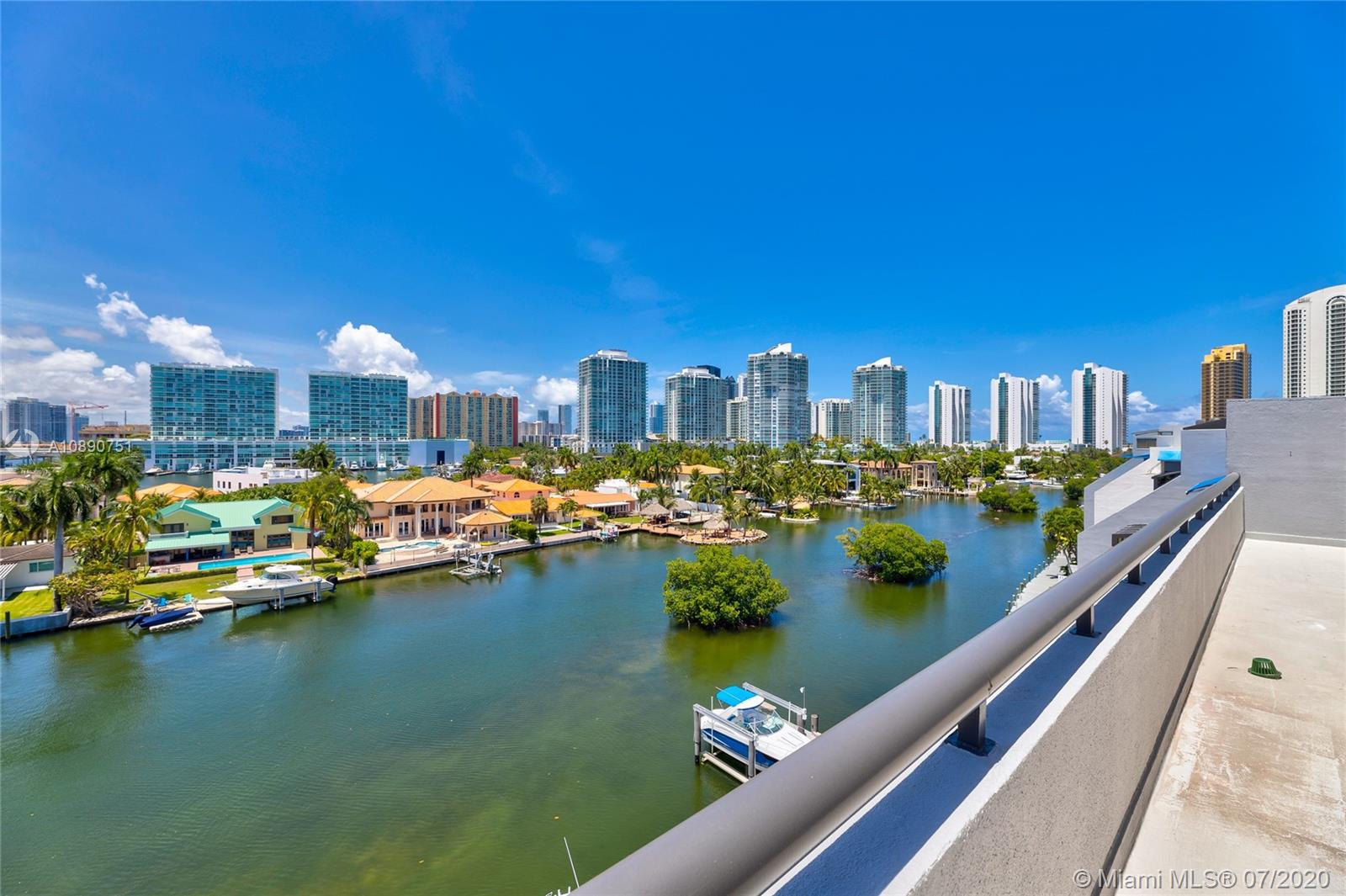 Photo of 425 Poinciana Island Drive #1444, Sunny Isles Beach, Florida, 33160 - View from terrace of boat docks and the marina which wraps around the complex