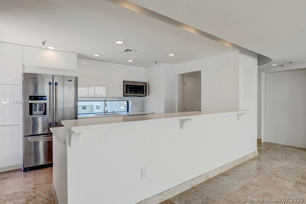 Photo of 425 Poinciana Island Drive #1444, Sunny Isles Beach, Florida, 33160 - View of kitchen with new s/s appliances and view to east terrace