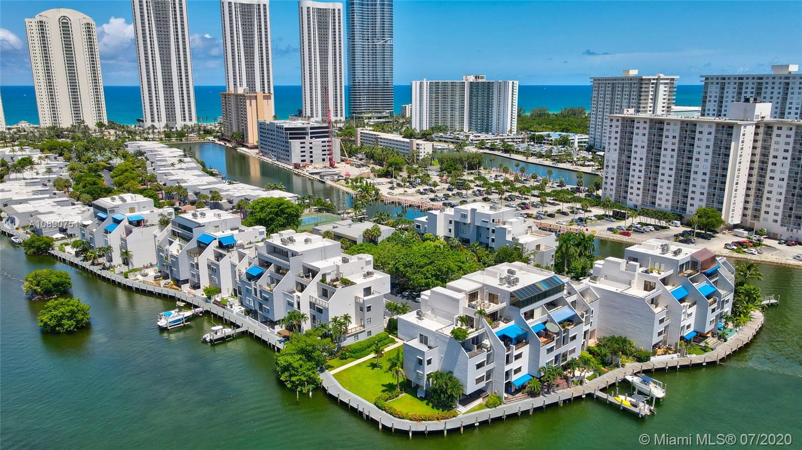 Photo of 425 Poinciana Island Drive #1444, Sunny Isles Beach, Florida, 33160 - Boardwalk wraps and around the complex and is scattered with boat docks