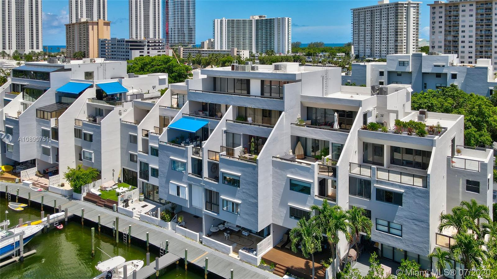 Photo of 425 Poinciana Island Drive #1444, Sunny Isles Beach, Florida, 33160 - Aerial view of complex, PH unit is top unit above the closest boat dock on left side of island, PH 425