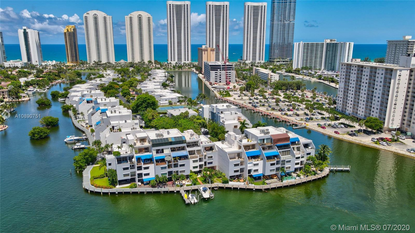 Photo of 425 Poinciana Island Drive #1444, Sunny Isles Beach, Florida, 33160 - Aerial view of complex, PH unit is top unit above the closest boat dock
