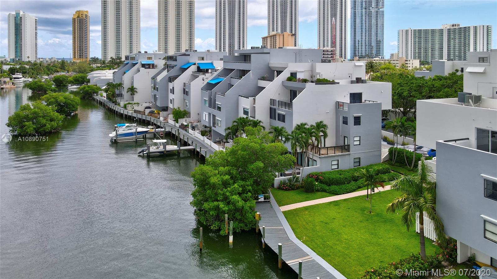 Photo of 425 Poinciana Island Drive #1444, Sunny Isles Beach, Florida, 33160 - Aerial view of Poinciana Island Yacht and Racquet Club with Sunny Isles Beach ocean towers in the background