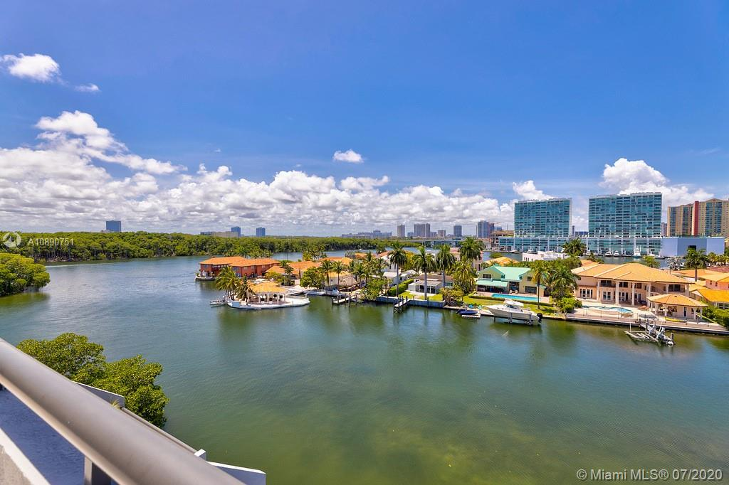 Photo of 425 Poinciana Island Drive #1444, Sunny Isles Beach, Florida, 33160 - Floor to ceiling glass windows pass through to grand terrace overlooking the Intercoastal water way and tranquil Oleta River State Park