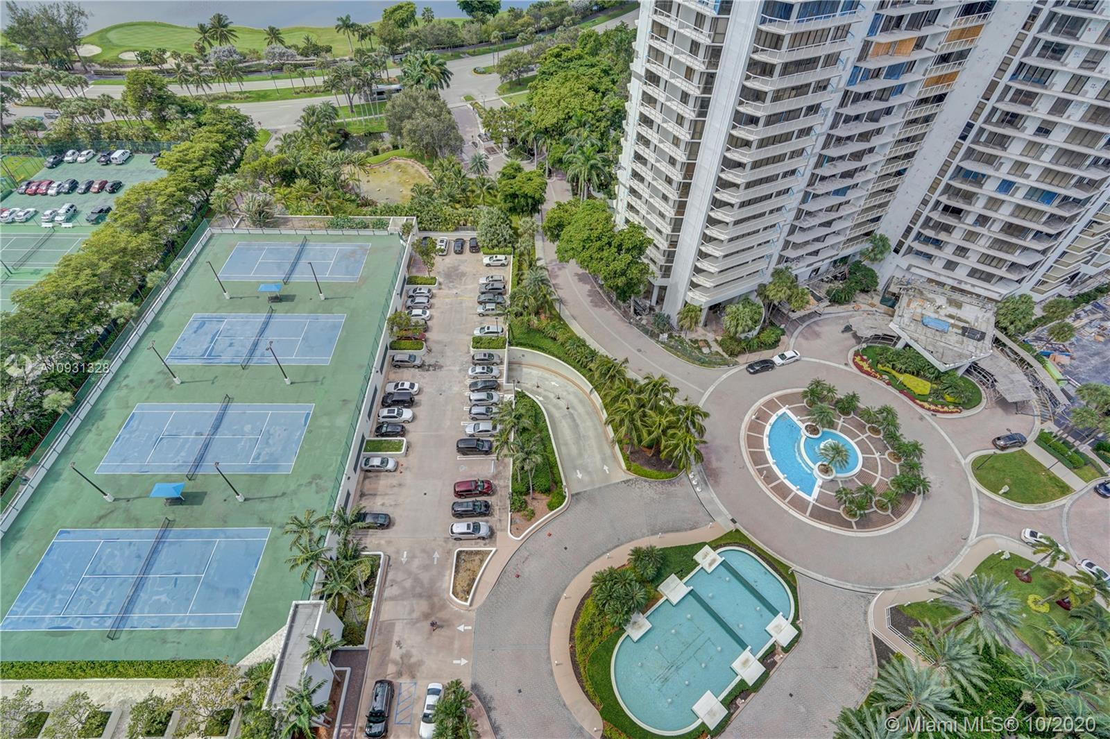 Photo of 20201 Country Club Dr #2407, Aventura, Florida, 33180 - Tennis courts and barbecue area.