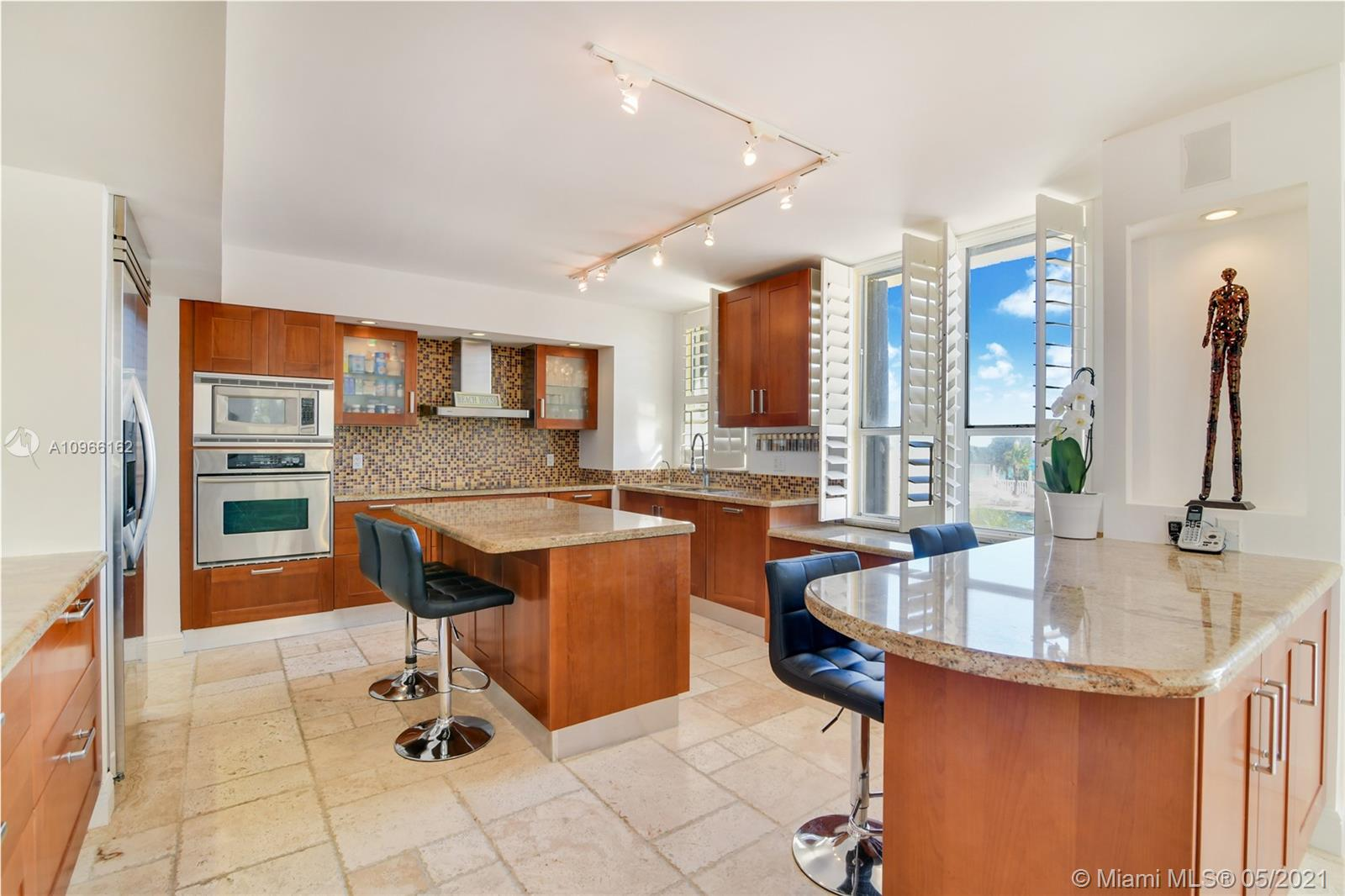 Photo of 9801 Collins Ave #4Z Direct Ocean, Bal Harbour, Florida, 33154 - Living room and kitchen looking the ocean and the pool