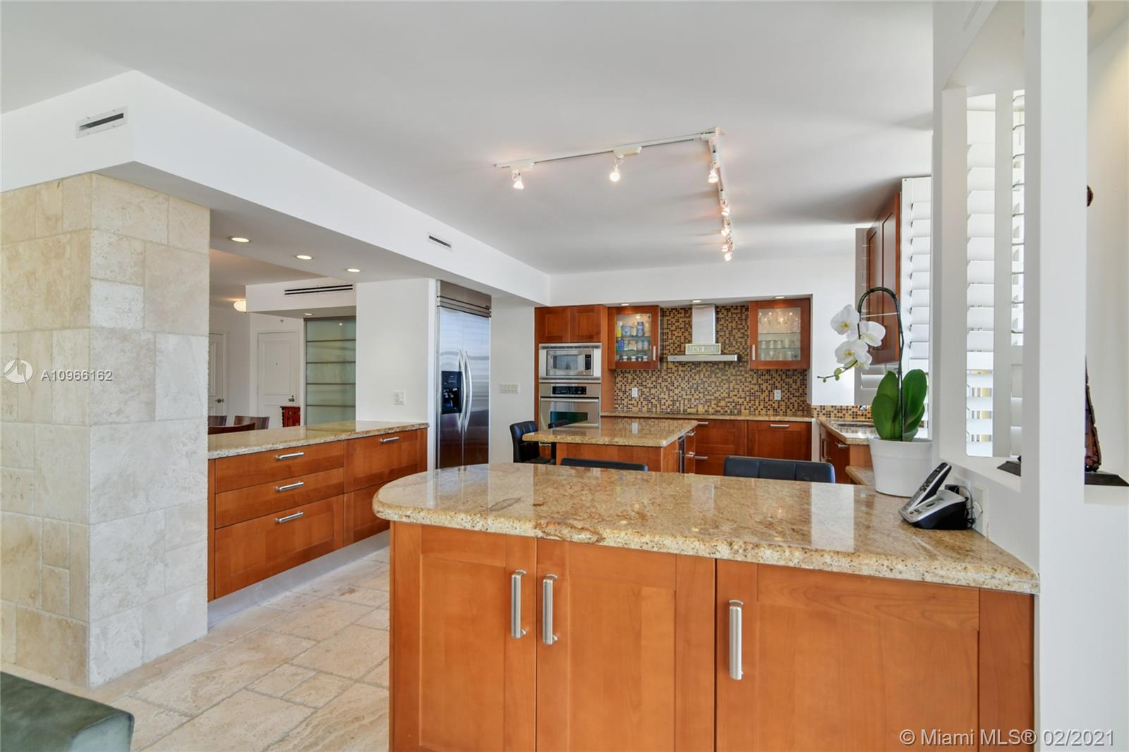 Photo of 9801 Collins Ave #4Z Direct Ocean, Bal Harbour, Florida, 33154 - Beautiful open Modern illuminated kitchen  looking the ocean views sunrise