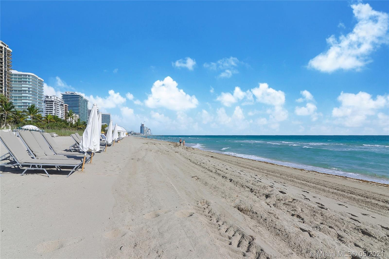 Photo of 9801 Collins Ave #10R, Bal Harbour, Florida, 33154 - Balmoral Beach service (chairs, table umbrella, towels, water)