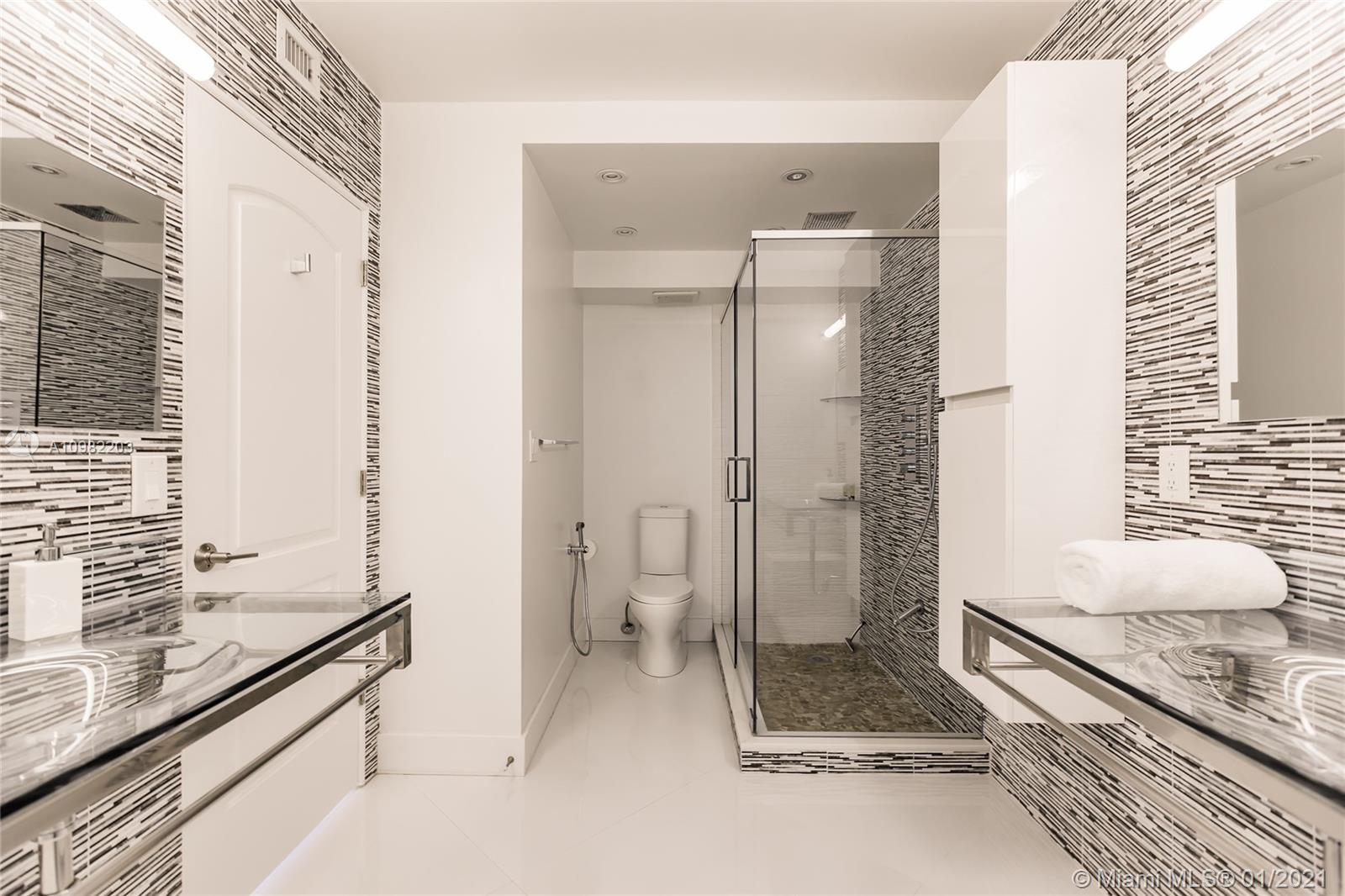 Photo of 3725 Ocean Dr #1504, Hollywood, Florida, 33019 - Separate master suite has a large walk-in closet as well as a work-station with printer.