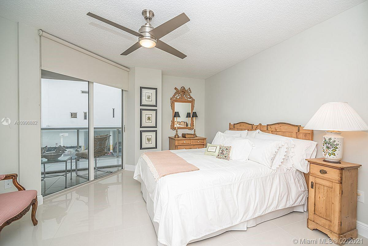 Photo of 8925 Collins Ave #2H, Surfside, Florida, 33154 - Master bathroom with walk in closet behind mirror doors.