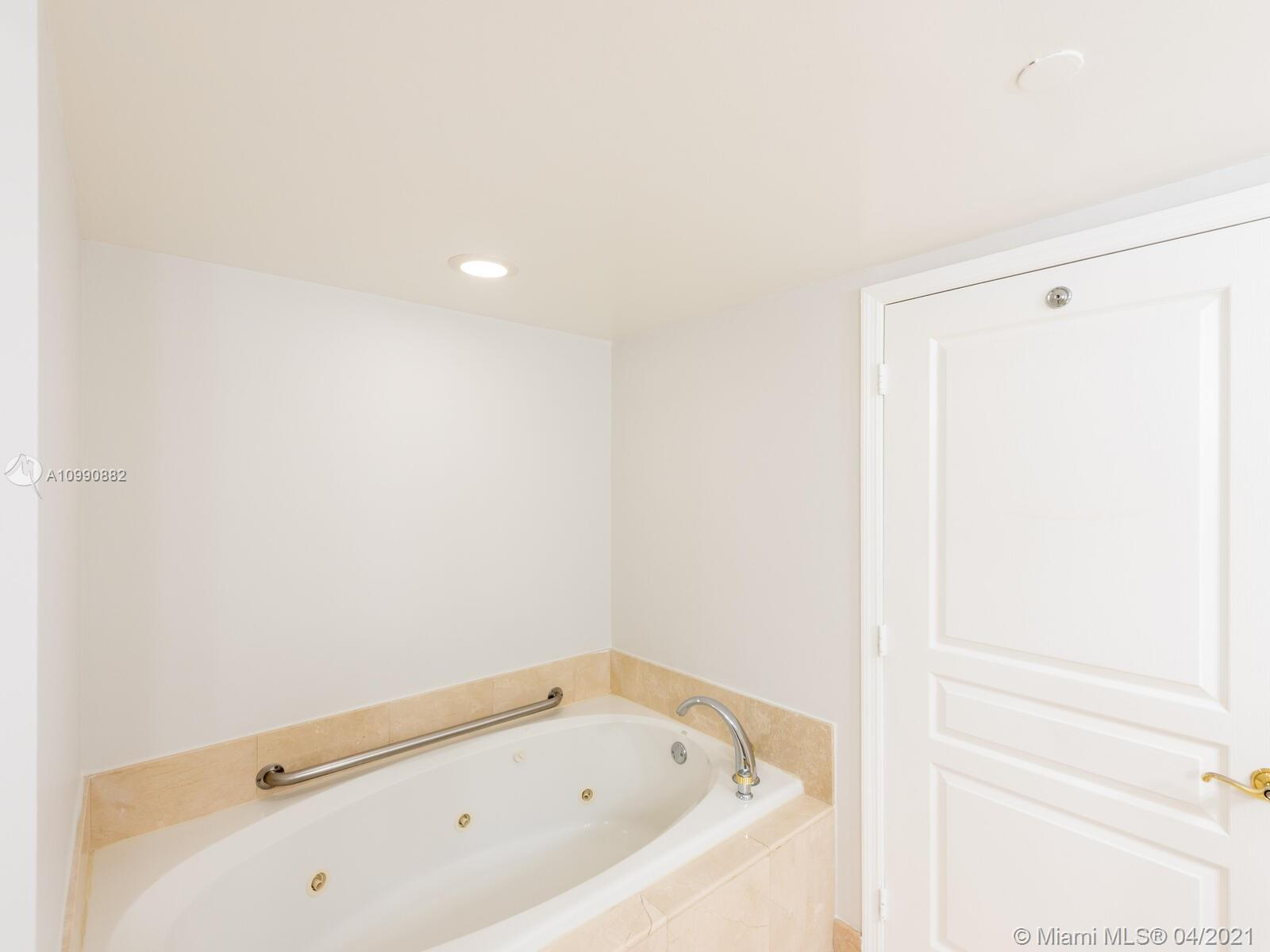 Photo of 8925 Collins Ave #2H, Surfside, Florida, 33154 - Master bathroom.  (Sink counter tops replaced with white quartz countertops).