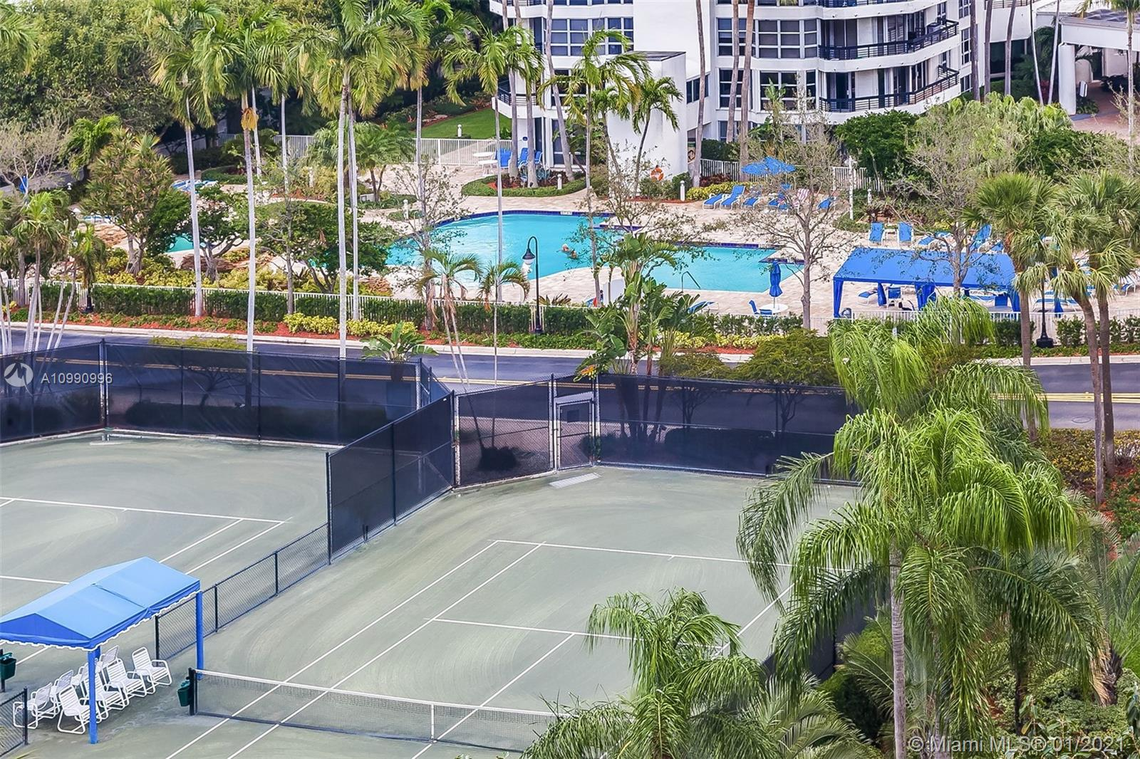Photo of 3600 Mystic Pointe Dr #117, Aventura, Florida, 33180 - Mystic Pointe has eight tennis clay tennis courts and a tennis pro.