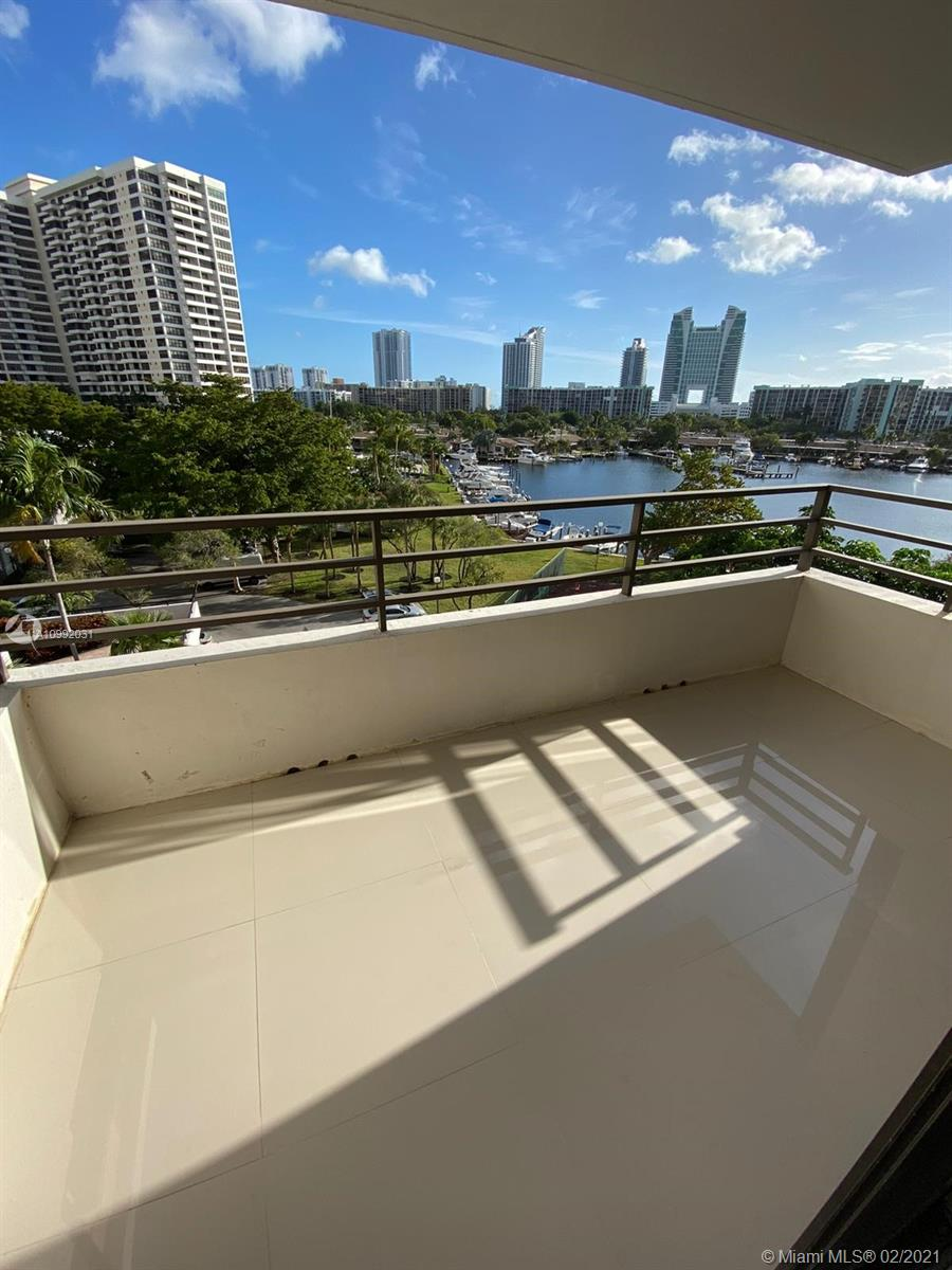Photo of 500 Three Islands Blvd #223, Hallandale Beach, Florida, 33009 - Balcony view, Tennis Court and water view