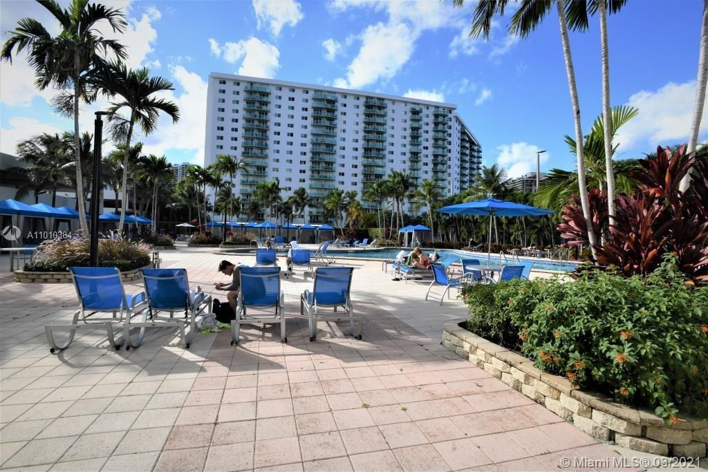 Photo of 19370 Collins Ave #721, Sunny Isles Beach, Florida, 33160 - View of the pool and the Tennis Court