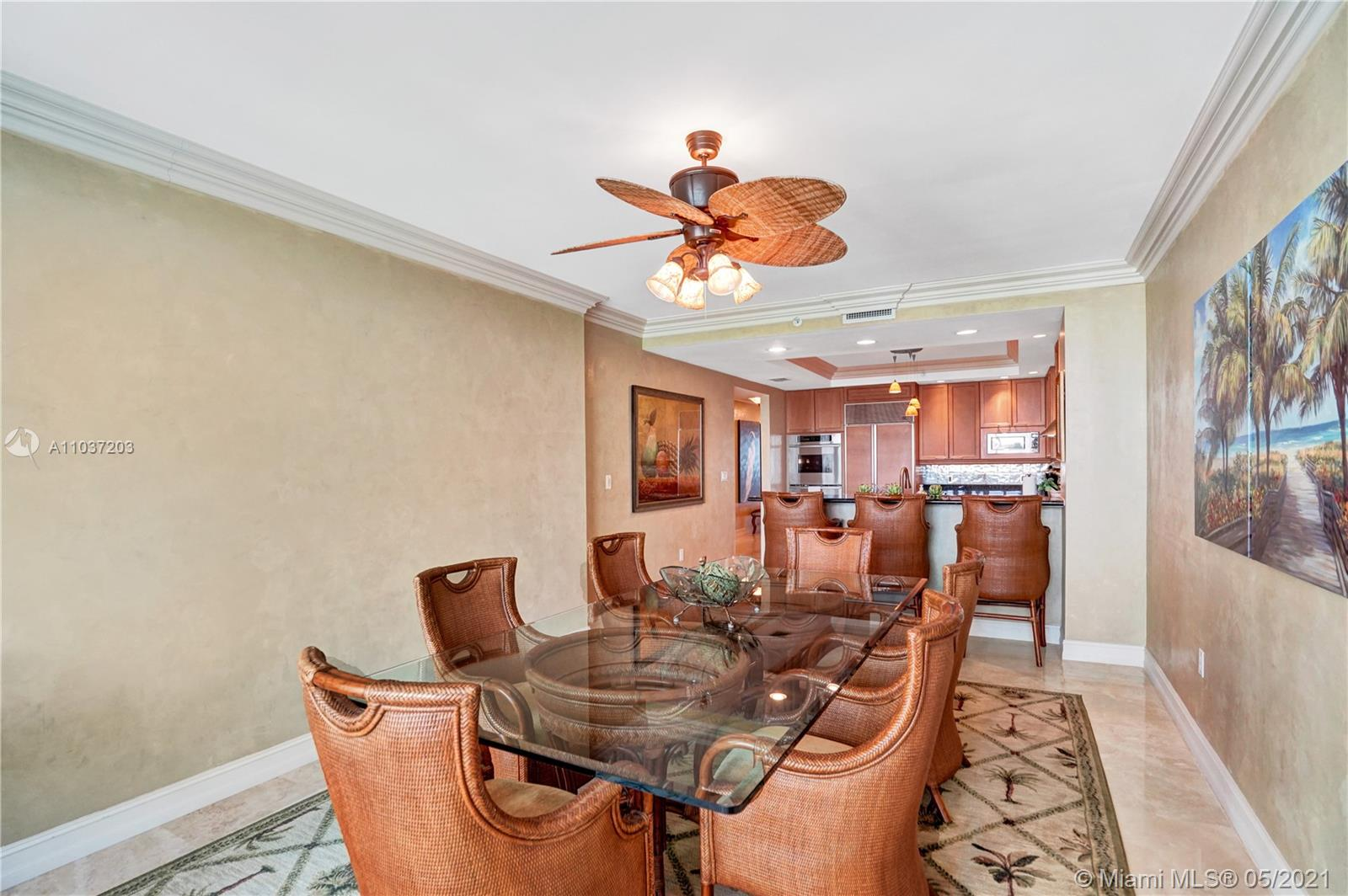 Photo of 20201 Country Club Dr #1006, Aventura, Florida, 33180 - Dining room with magnificent lake and city views.