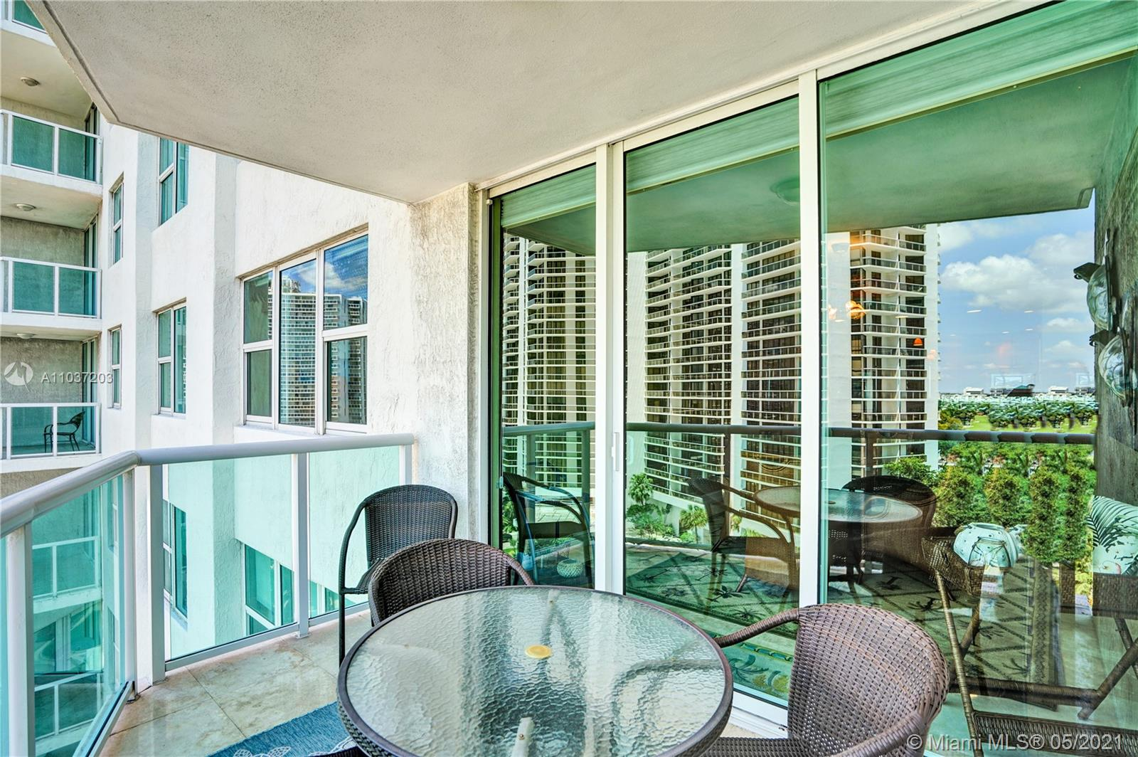 Photo of 20201 Country Club Dr #1006, Aventura, Florida, 33180 - Calm, relaxing water views.