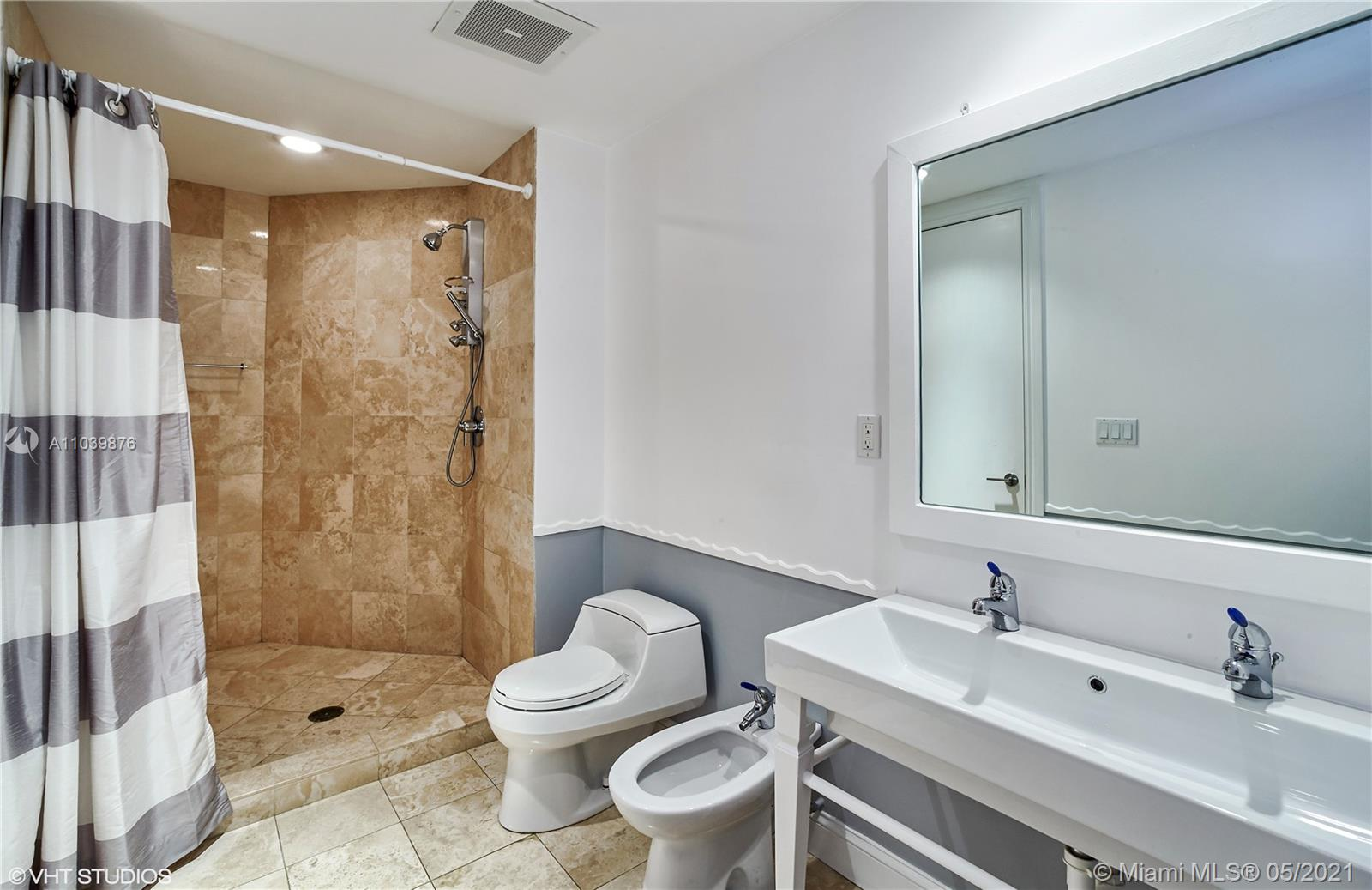 Photo of 10225 Collins Ave #1703, Bal Harbour, Florida, 33154 - Second bedroom with en-suite bathroom overlooking the beach, Atlantic Ocean, Haulover Inlet and One Bal Harbour/Ritz Carlton Residences.